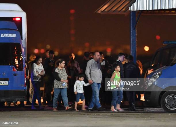 Migrants prepare to board buses at a refugee centre in the Midia Port at the Black Sea coast next to Navodari city September 13 2017 EU member...