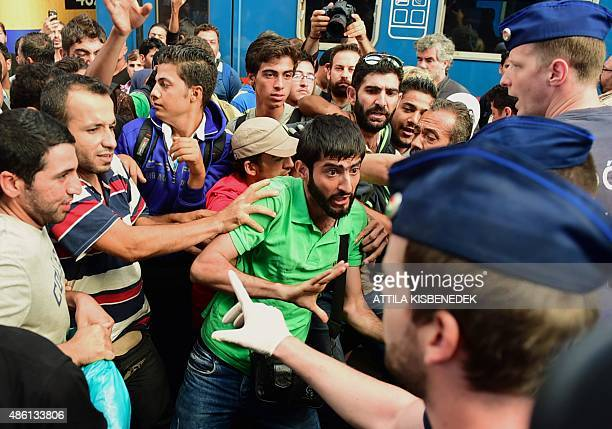 Migrants protest at the Eastern railway station of Budapest on September 1 during the evacuation of the railway station by local police Budapest's...