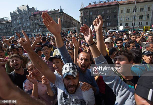 Migrants protest outside Keleti station in central Budapest after it was closed to migrants earlier today on September 1 2015 in Budapest Hungary The...