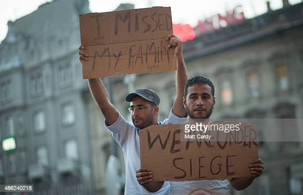 Migrants protest outside Keleti station which remains closed to them in central Budapest September 2 2015 in Budapest Hungary The station was closed...