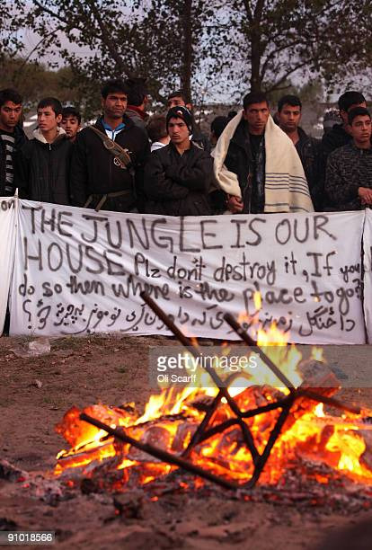Migrants protest to preserve the migrant camp known as 'The Jungle' adjacent to a ferry terminal to the UK on the morning that was raided by police...