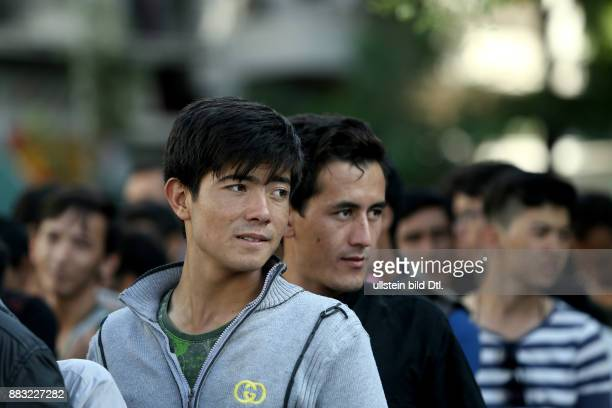 Migrants queue during a free meal distribution Over 1000 migrants and refugees from Afghanistan Syria Iran and Iraq live for more than a month in...