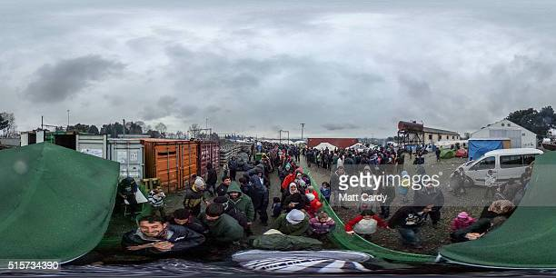 Migrants queue for food at the Idomeni refugee camp on March 15 2016 in Idomeni Greece The decision by Macedonia to close its border to migrants on...