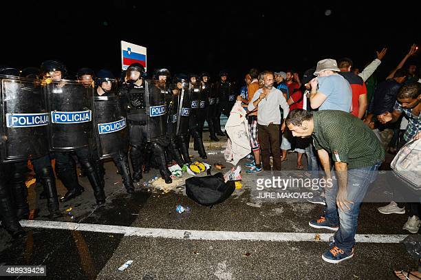 Migrants react after pepper spray was used in a small village of Rigonce in Slovenia a small border crossing point to Harmica Croatia on September 18...