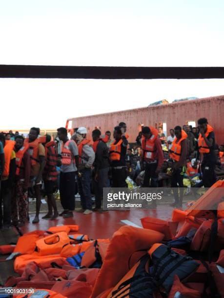 Migrants rescued from the Mediterranean on board the Aquarius a boat belonging to the NGO Doctors Without Borders off the Italian coast 27 June 2017...