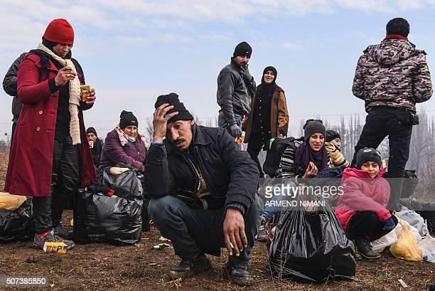 Migrants rest after crossing the Macedonian border into Serbia near the village of Miratovac on January 29 2016 More than one million people reached...