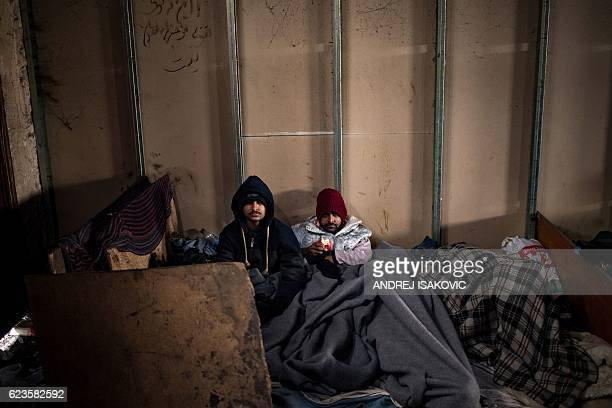 Migrants rest in a makeshift shelter in an abandoned warehouse in Belgrade on November 16, 2016. Hundreds of thousands of migrants had passed through...