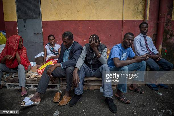 Migrants rest in quotBaobabquot migration centre next to the Tiburtina train station in Rome on June 15 2015 Hundreds of migrants mainly from Eritrea...
