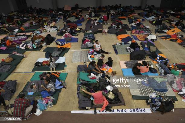 Migrants rest inside a temporary migrant shelter next to the USMexico border on November 17 2018 in Tijuana Mexico Parts of the migrant caravan have...