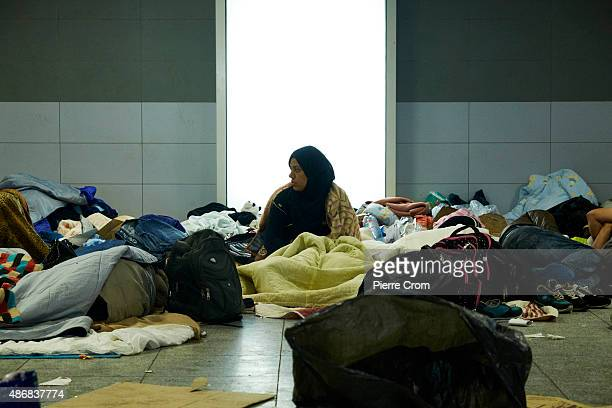 Migrants rest inside Keleti Station on 05 September 2015 in Budapest Hungary Last night the Hungarian government ordered a fleet of buses to take...