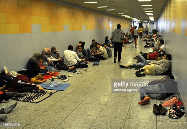 Migrants rest inside the main Eastern Railway station in Budapest Hungary September 02 2015 Hundreds of angry migrants demonstrated on Tuesday...