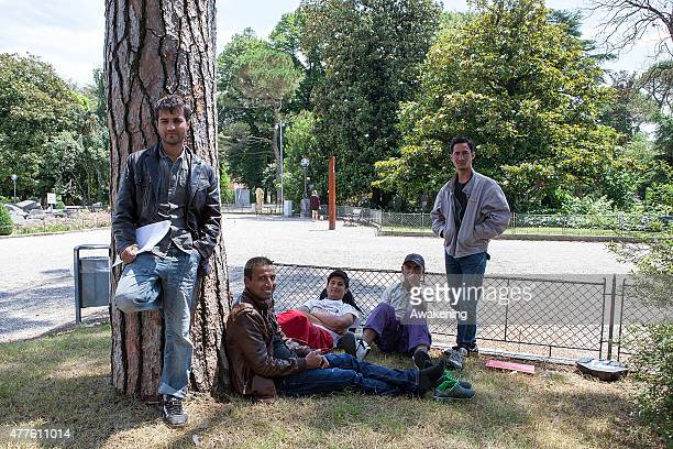 Migrants rest on a bench in the park near the Red Cross unit on June 18 2015 in Gorizia Italy Approximately 50 migrants enter Italy through the...