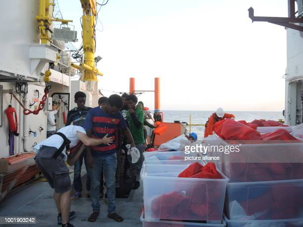 Migrants saved from a precarious rubber dinghy by Doctors without borders receive medical care on board the rescue ship 'Aquarius' in the...