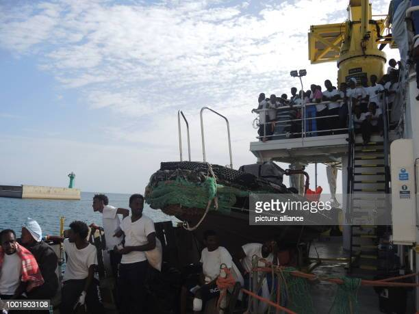 Migrants saved from a precarious rubber dinghy by volunteers of SOSMediterranee are taken on board the rescue ship 'Aquarius' in the Mediterranean...