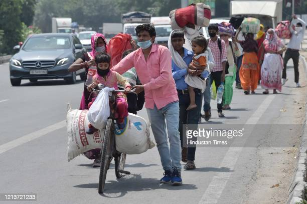 Migrants seen at Sarai Kale Khan while journeying back to their homes in Uttar Pradesh's Hardoi during lockdown on May 18 2020 in New Delhi India