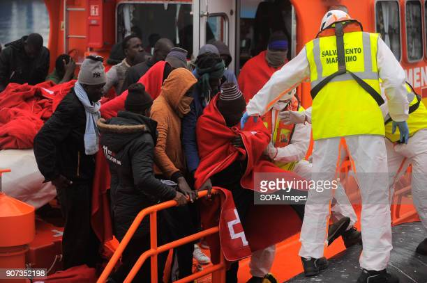 Migrants seen disembarking from the Spanish coast guard's boat as they arrive on Spanish soil Arrival of a group of migrants rescued in the...