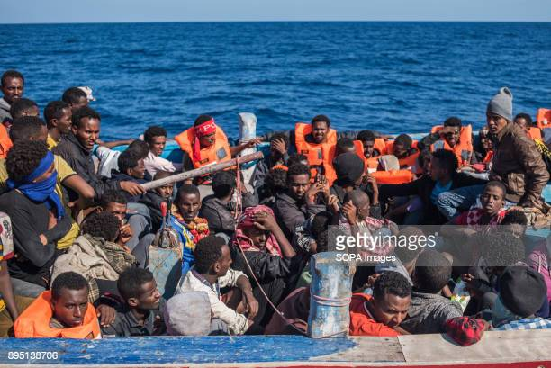 Migrants seen packed in their boat crossing the ocean into Europe They were coming from Libya and rescued by the Spanish NGO Proactiva Open Arms The...