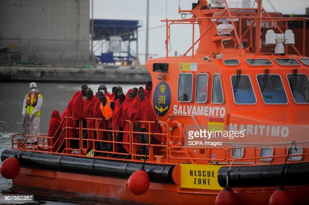 Migrants seen packed on a Spanish coast guard's boat as they arrive at the port of Malaga Arrival of a group of migrants rescued in the Mediterranean...