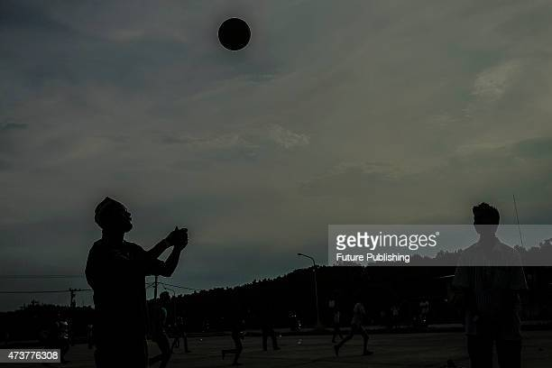 Migrants seen playing at a temporary shelter on May 17 2015 in Kuala Langsa Indonesia Hundreds of migrants from Myanmar and Bangladesh have taken...