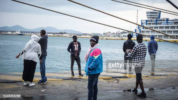 Migrants seen standing at the port during their arrival 400 migrants and refugees were transferred upon their arrival from the island of Lesbos...