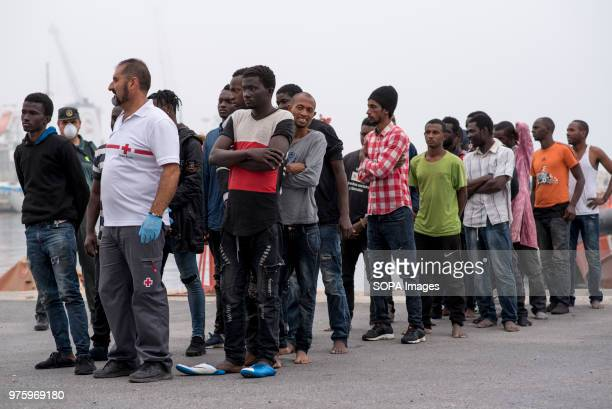 PORT MOTRIL GRANADA SPAIN Migrants seen waiting in line after their arrival 45 men and 8 women have been rescued from a dinghy and brought at Motril...