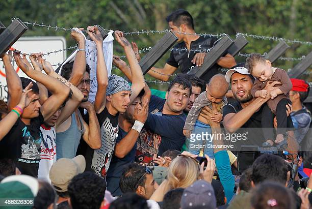 Migrants shout to open the Horgos Border near the town of Kanjiza after Hungarian authorities closed their border on September 15 2015 in Horgos...