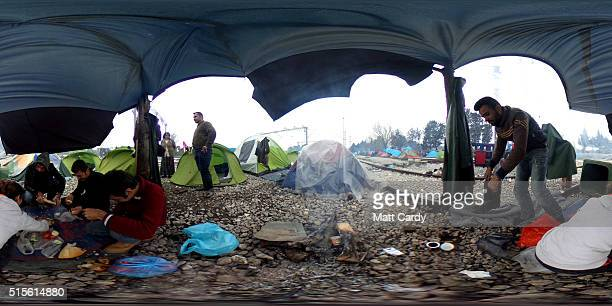 Migrants sit in tent at the Idomeni refugee camp on March 14 2016 in Idomeni Greece The decision by Macedonia to close its border to migrants on...