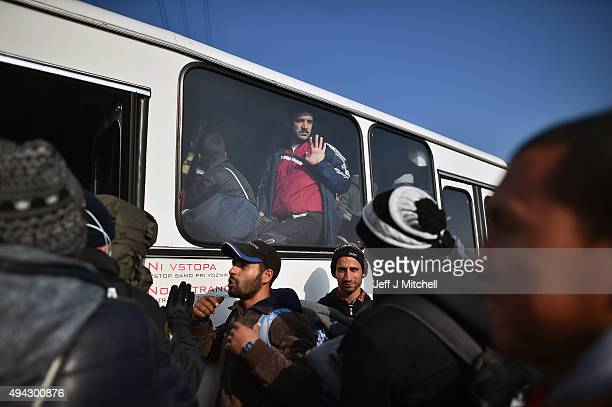 Migrants sit inside buses as they are transported to Brezice refugee camp on October 26 2015 in Rigonce Slovenia Thousands of migrants marched across...