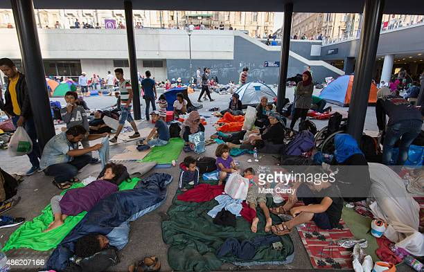 Migrants sleep in the transit zone of Keleti station which remains closed to them in central Budapest on September 2 2015 in Budapest Hungary The...