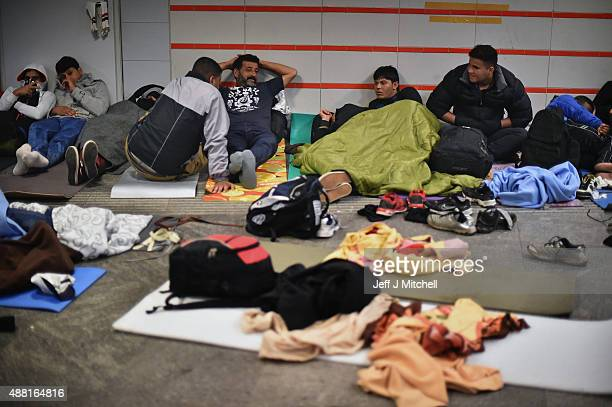 Migrants sleep near Keleti railway station as they wait to board trains leaving for the Austrian border on September 14 2015 in Budapest Hungary...