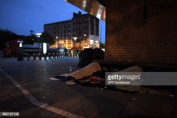 Migrants sleep on the floor in SaintDenis outside Paris on October 11 2017 Unprecedented waves of migration are affecting the world today with record...