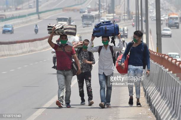 Migrants spotted along Meerut Expresway while journeying to their homes in Uttar Pradesh during lockdown on May 18 2020 in New Delhi India