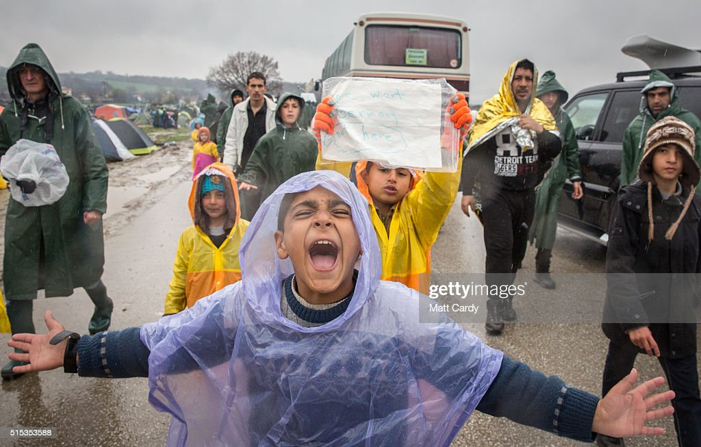 Migrants stage a protest march about the continued closure of the Macedonian Greek border the Idomeni refugee camp on March 13, 2016 in Idomeni, Greece. The decision by Macedonia to close its border to migrants on Wednesday has left thousands of people stranded at the Greek transit camp. The closure, following the lead taken by neighbouring countries, has effectively sealed the so-called western Balkan route, the main migration route that has been used by hundreds of thousands of migrants to reach countries in western Europe such as Germany. Humanitarian workers have described the conditions at the camp as desperate, which has been made much worse by recent bouts of heavy rain.