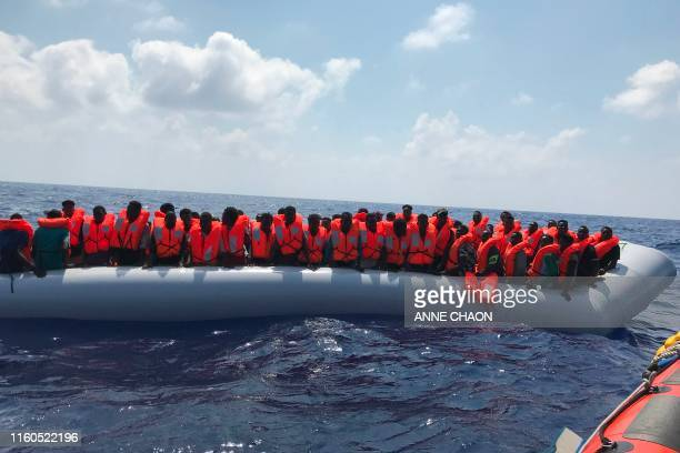TOPSHOT Migrants stand on an inflatable boat on August 10 during the second rescue operation of crew members of the 'Ocean Viking' rescue ship...