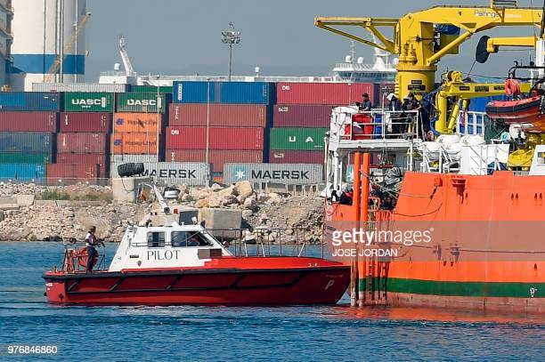 Migrants stand on the deck of the Aquarius as the ship enters the port of Valencia on June 17 2018 The 630 migrants whose rescue sparked a major...