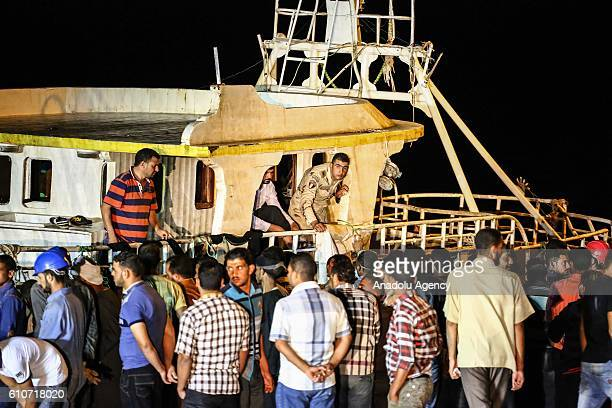 Migrants' submerged boat is taken out from sea at Port Rashid in Beheira Egypt on September 27 2016 Migrants' boat submerged on its way to Europe at...