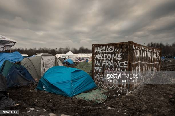 TOPSHOT Migrants' tents are pictured in the migrants camp of GrandeSynthe near Dunkirk on January 20 where almost some 2500 migrants and refugees...