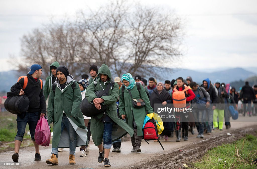 Migrants trek towards Macedonia after leaving the Idomeni refugee camp, on March 14, 2016 in Idomeni, Greece. The decision by Macedonia to close its border to migrants on Wednesday has left thousands of people stranded at the Greek transit camp. The closure, following the lead taken by neighbouring countries, has effectively sealed the so-called western Balkan route, the main migration route that has been used by hundreds of thousands of migrants to reach countries in western Europe such as Germany. Humanitarian workers have described the conditions at the camp as desperate, which has been made much worse by recent bouts of heavy rain.