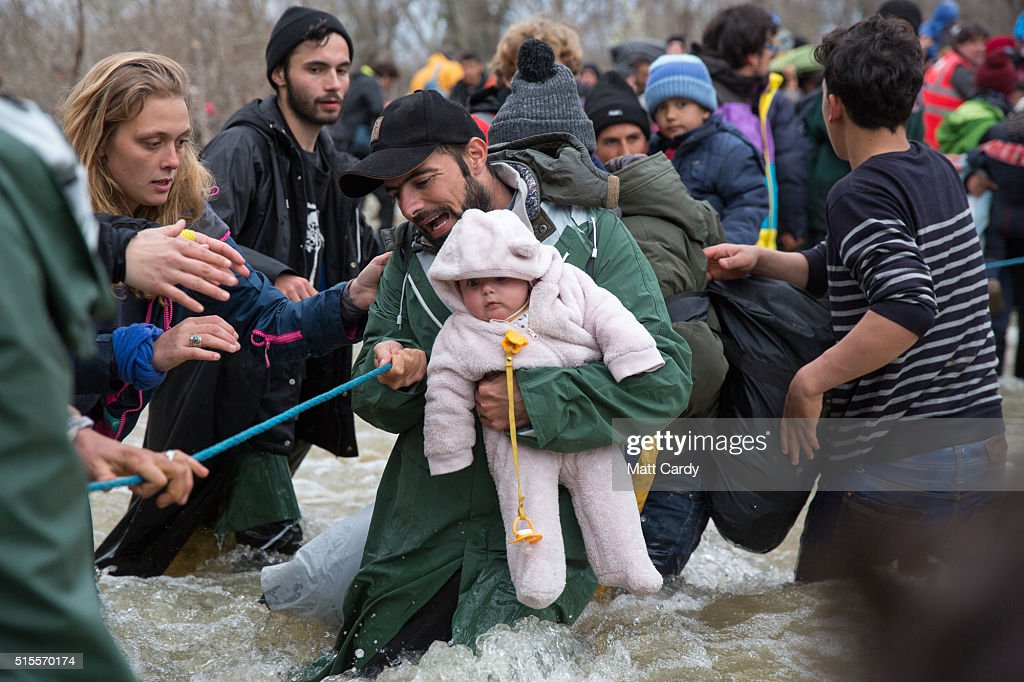 Frustrated Migrants Stranded On The Border Attempt To Walk In To Macedonia : News Photo