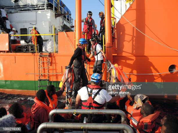 Migrants wait a board a small boat a socalled RHIB for their transfer onto the rescue ship Aquarius in the Mediterranean 27 June 2017 The aid...
