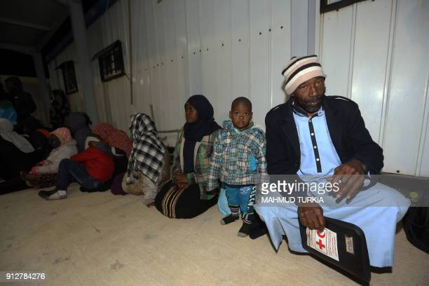 Migrants wait at a naval base in Tripoli late on January 31 after they were rescued off Lybia's coast About 240 illegal migrants from Arab and...