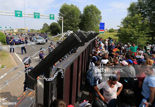 Migrants wait at the Horgos Border near the town of Kanjiza after Hungarian authorities closed their border on September 15 2015 in Horgos Serbia...