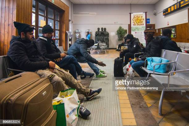 Migrants wait at the railway station hoping to reach the French border on December 21 2017 in Bardonecchia Turin Italy After the police reinforced...