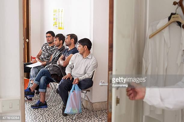 Migrants wait at the Red Cross unit for their medical examination on June 18 2015 in Gorizia Italy Approximately 50 migrants enter Italy through the...
