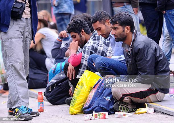 Migrants wait at the transit zone of Eastern railway main station in Budapest on September 5 2015 as several thousand refugees were transported by...