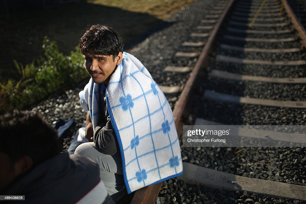 Migrants wait in a holding area just metres across the Hungarian border in the Austrian village of Heiligenkreuz on September 21, 2015 in Heiligenkreuz, Austria. Thousands of migrants have arrived in Austria over the wekend with more en-route from Hungary, Croatia and Slovenia. Politicians across the European Union are to hold meetings on the refugee crisis with EU interior ministers meeting tomorrow and EU leaders attending an extraordinary summit on Wednesday.