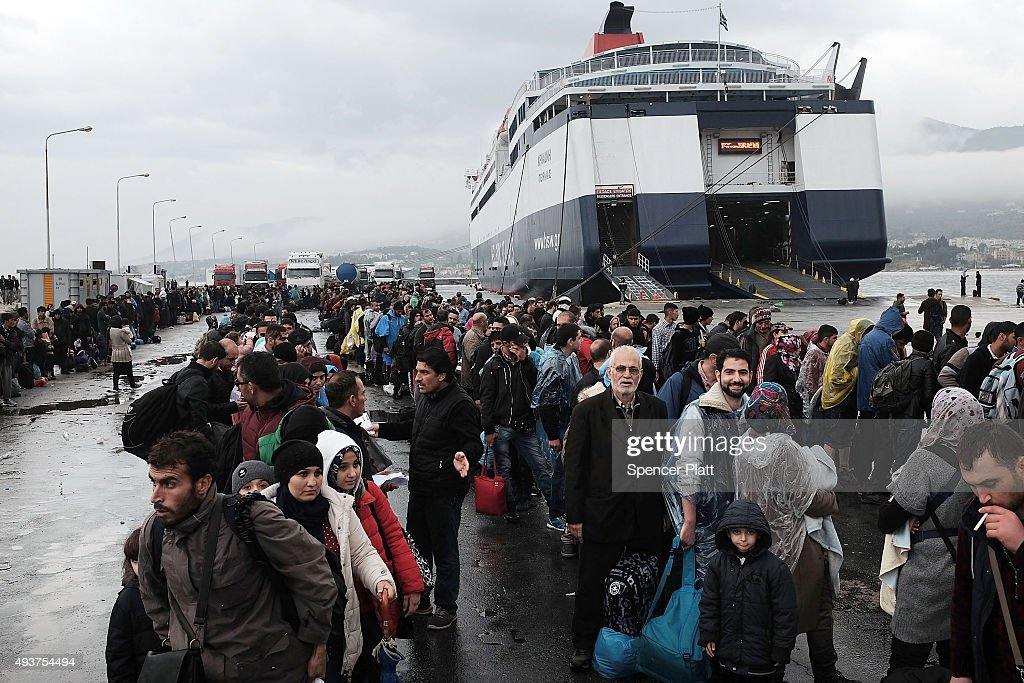 Migrants wait in the port for a ferry on the island of Lesbos on October 22, 2015 in Mytilene, Greece. Dozens of rafts and boats are still making the journey daily as thousands flee conflict in Iraq, Syria, Afghanistan and other countries. More than 500,000 migrants have entered Europe so far this year. Of that number, four-fifths have paid to be smuggled by sea to Greece from Turkey, the main transit route into the EU. Nearly all of those entering Greece on a boat from Turkey are from the war zones of Syria, Iraq and Afghanistan.