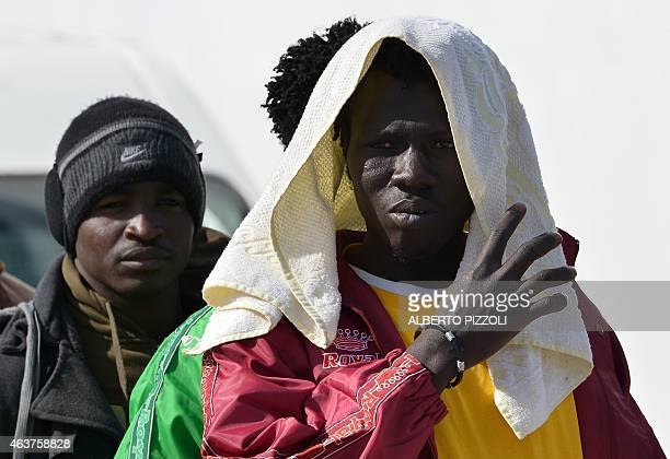 Migrants wait in the port of Lampedusa to board a ferry and be transferred to Porto Empedocle in Sicily on February 18 2015 Authorities on the...