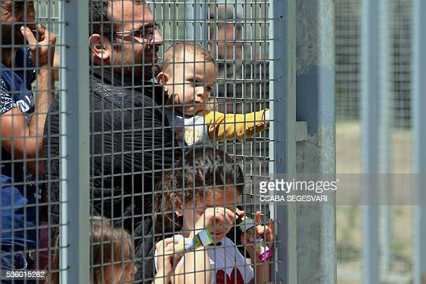 Migrants wait nearby the entrance of Hungarian transit zone near Roszke village on May 31 2016 as Hungary bolsters antimigrant fence on Serbia border...