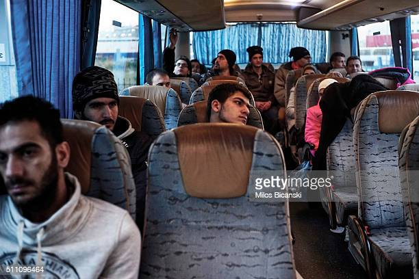 Migrants wait on a bus after arriving in Pireaus, port of Athens on Februray 18, 2016 in Athens, Greece. Migrants continue to pour into Greece as EU...